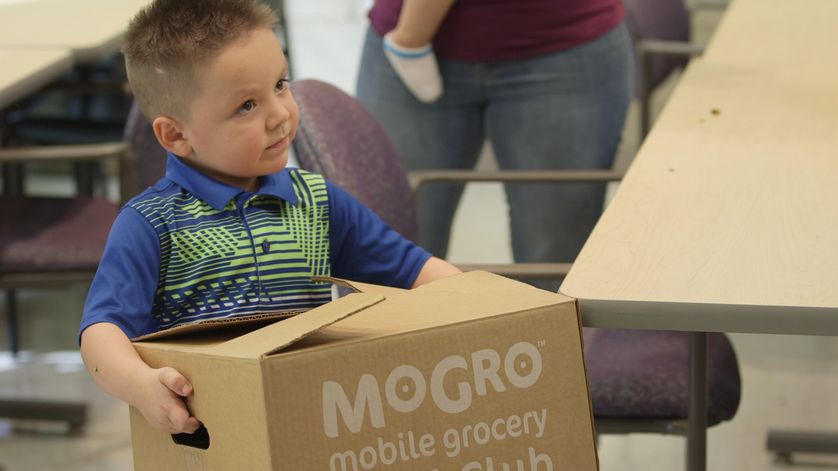 Little boy holding MoGro box