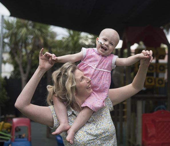 A mother's love: Nothing gives three-year-old Bonnie more delight than playing with her mummy.