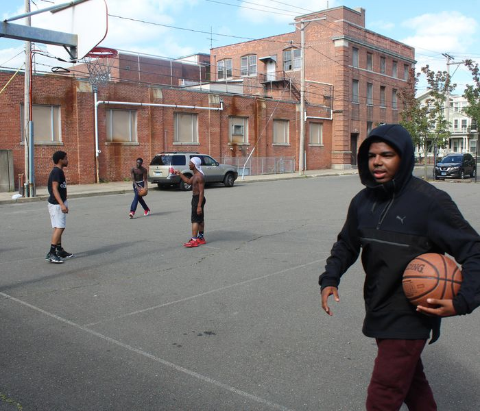 Students play basketball outside of New Light High School.