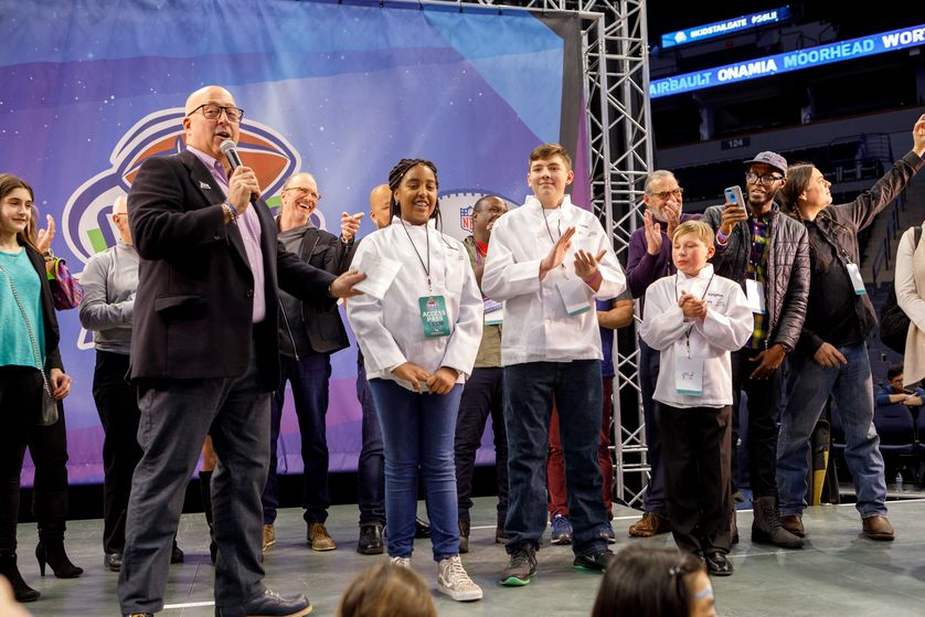 Andrew Zimmern with group of kid winners
