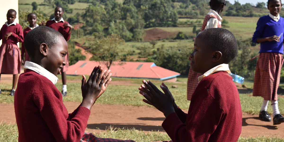 Sylvia and Mary (both 11) play outside after class at the Kakenya Center for Excellence.