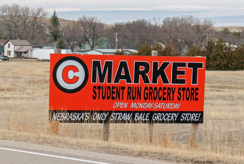 Sign for C Market in a rural field