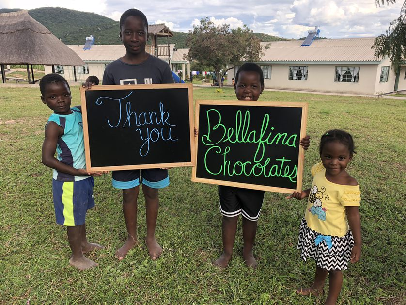 """Children in Zimbabwe hold """"thank you"""" signs"""
