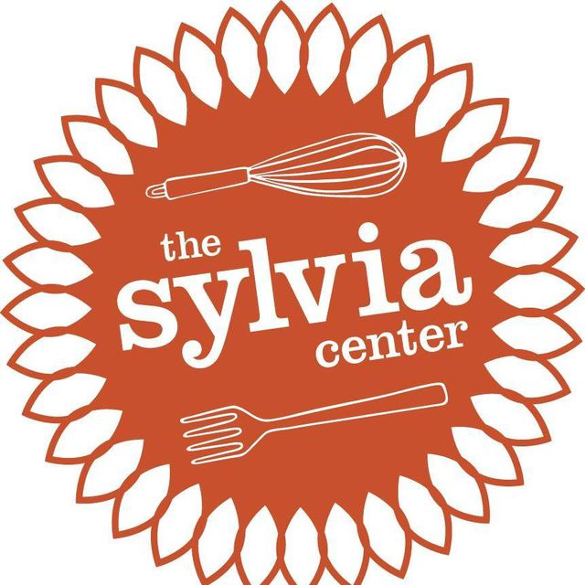 The Sylvia Center logo