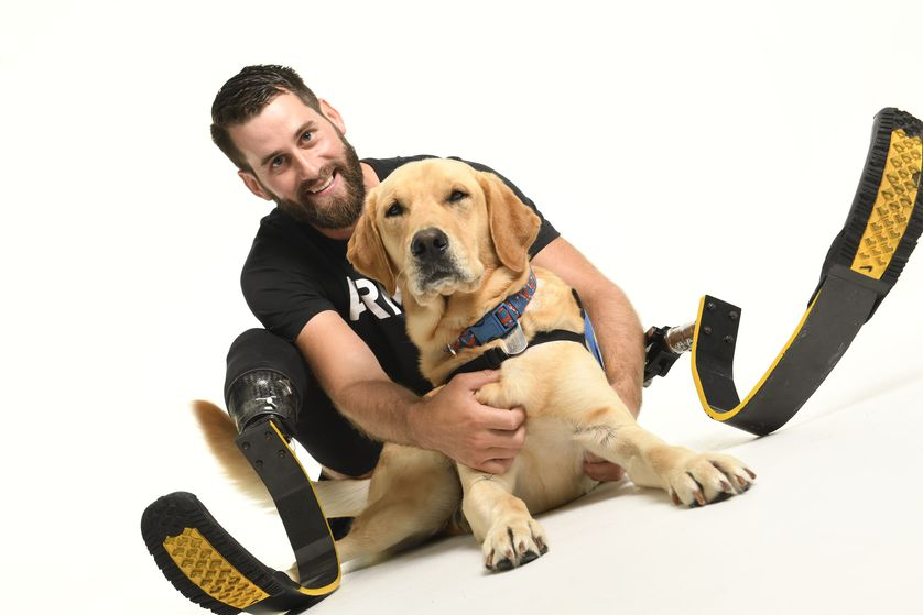 Stefan and dog pose with his running blades