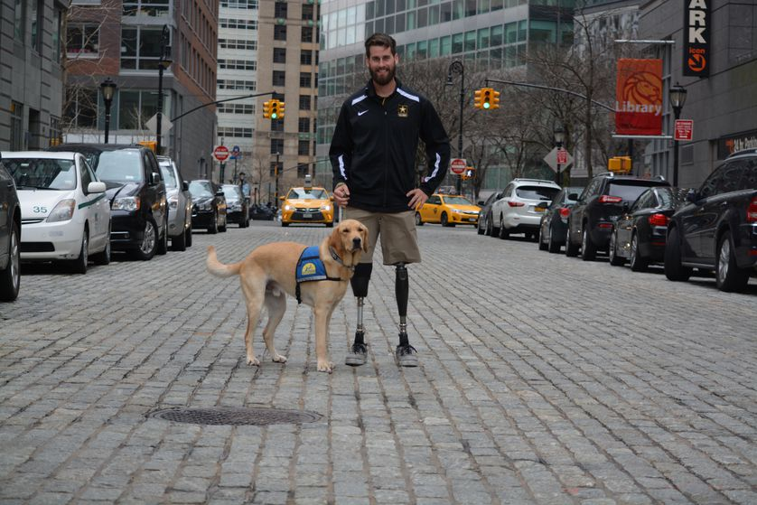 Stefan and guide dog stand in street