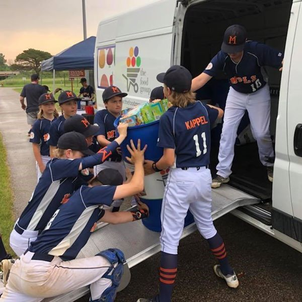 youth baseball loads up truck