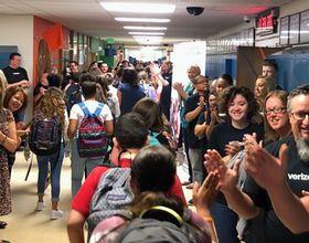 high fives for kids in hallway