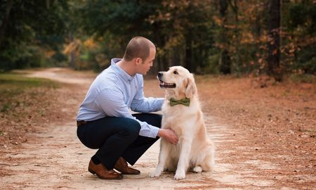 man and dog with bowtie