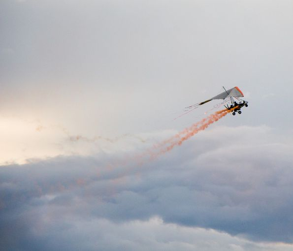 Glider dropping off water during fire
