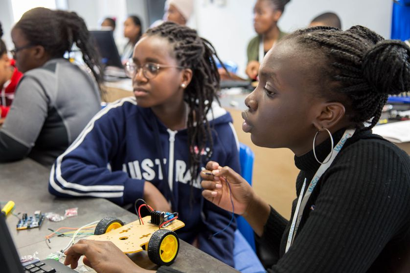Natalie (right) working on a Wall-E bot during Intel classes at WiSci Namibia.