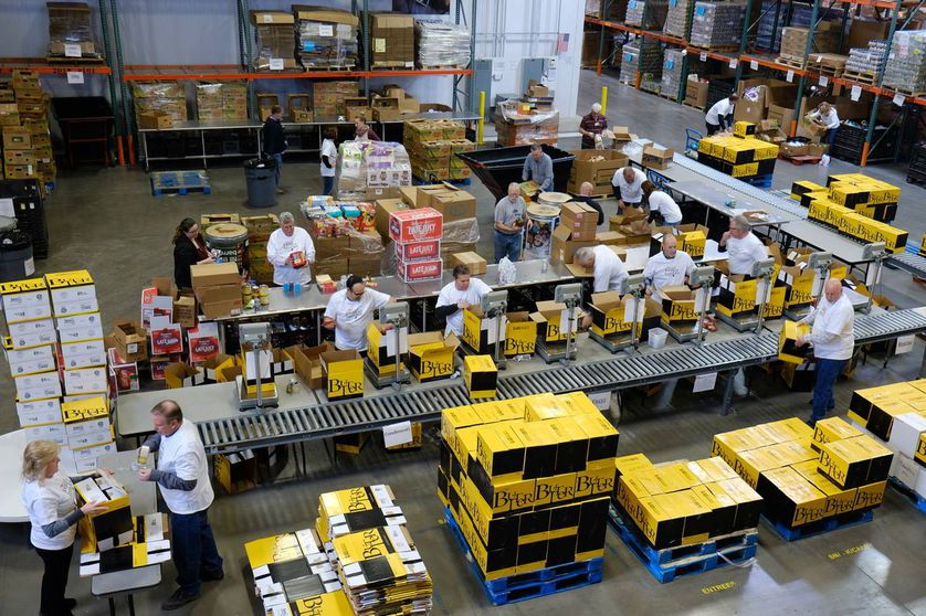 grocery store workers pack boxes