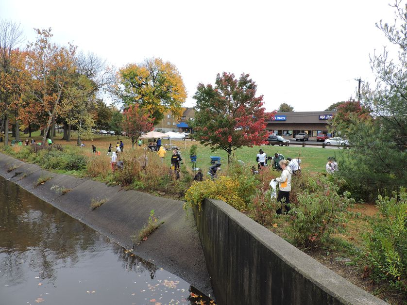 A river with people planting alongside