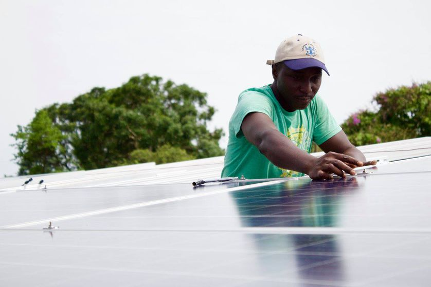 a man works on solar panel