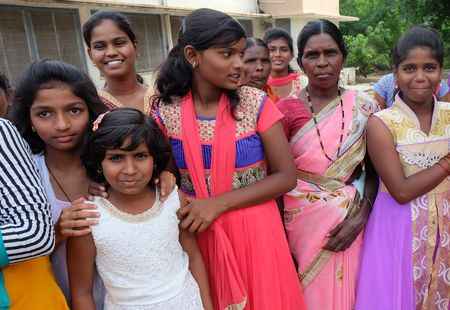 A group of women pose for camera in rural India