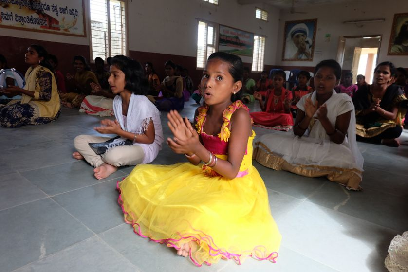 A group of girl students sing in classroom