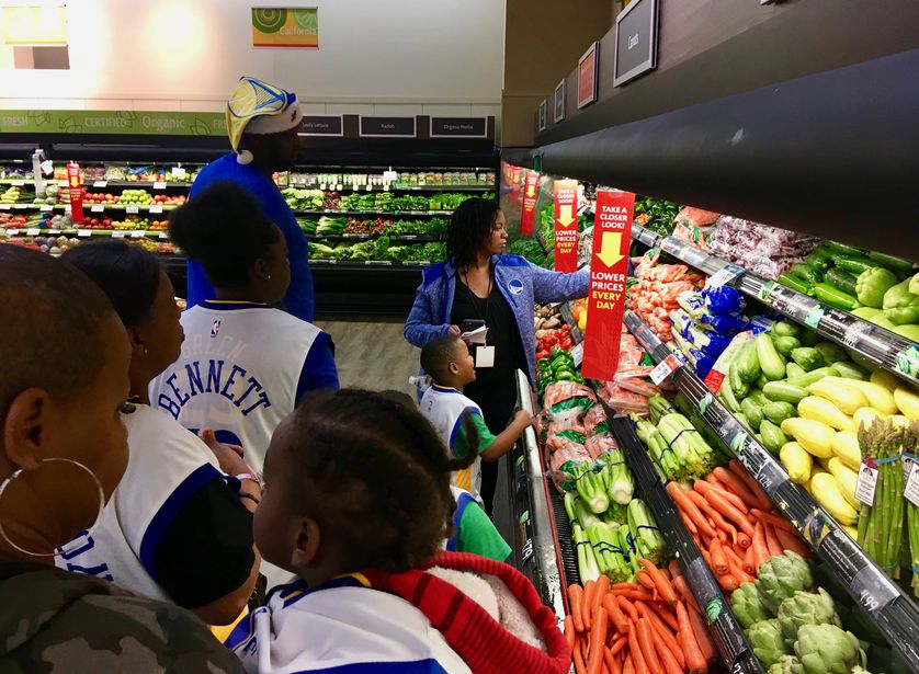 Aarena leads a class at grocery store