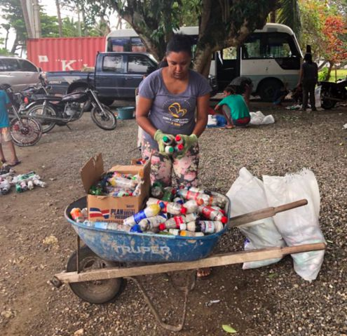 Mariposa employee collects trash in wheelbarrow