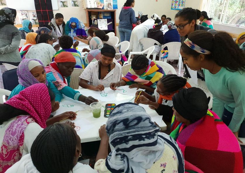 ethiopian women paint together at table
