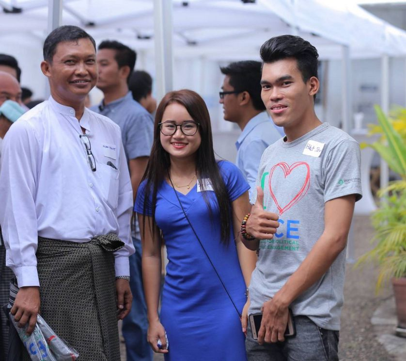 three people from Myanmar smile for World Learning