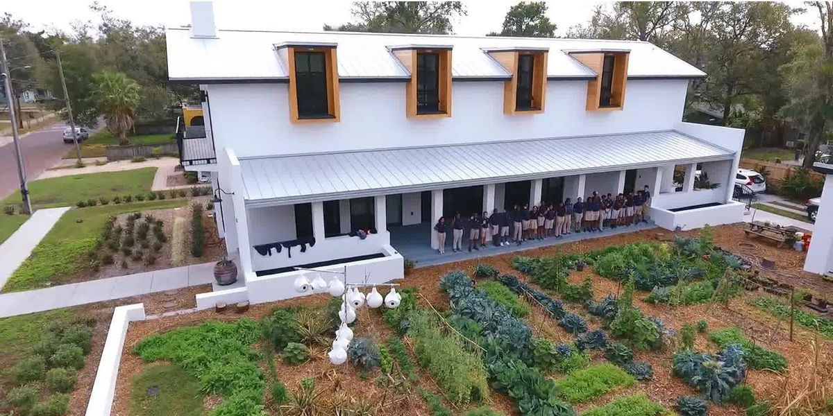 Emeril's cooking school building outside with garden