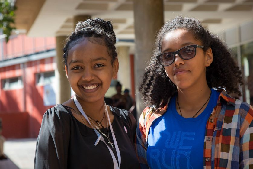 Two Ethiopian women smile at camera