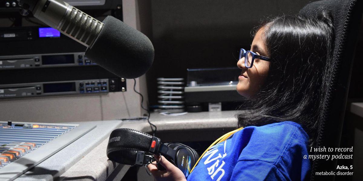 little girl sits in radio station with headphones