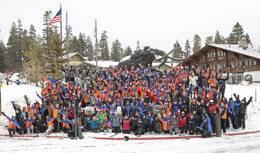 group shot of service members and veterans at ski resort