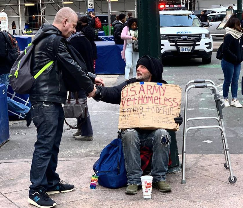 Founder shakes hands with homeless man