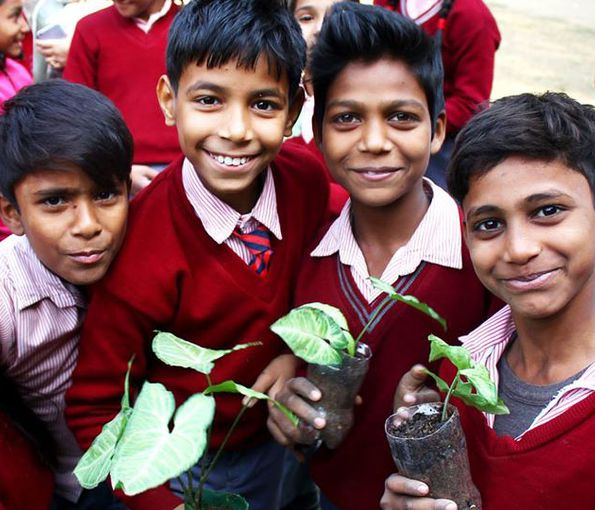 children pose with homemade air purification