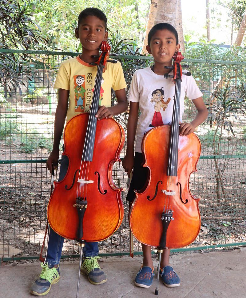 Two boys pose with classical instruments