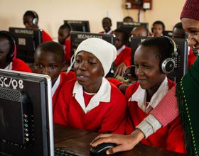 Powering Potential students learn new technology on computers
