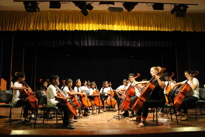 Children in India play in professional orchestra with trainees
