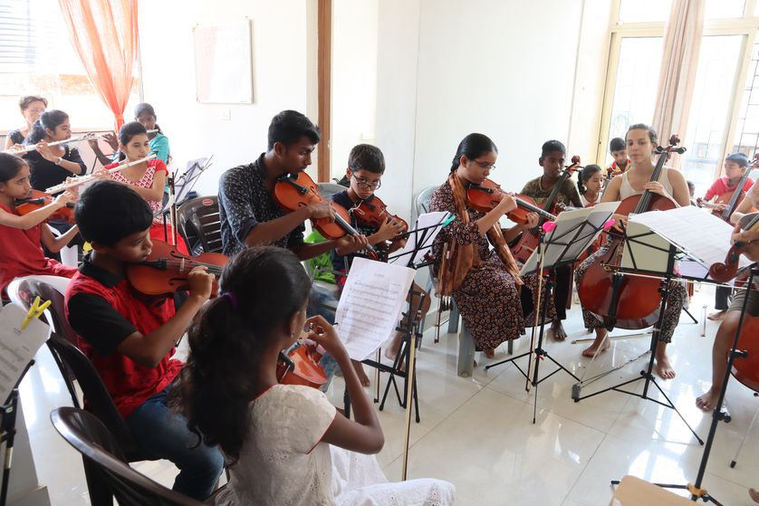 Indian children play in professional orchestra