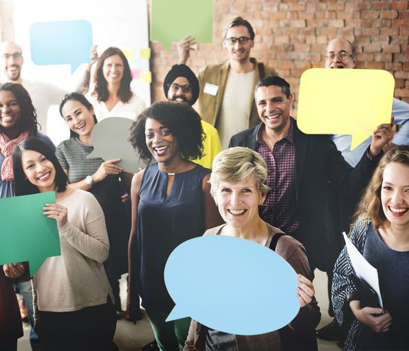 images of diverse people holding speech bubbles