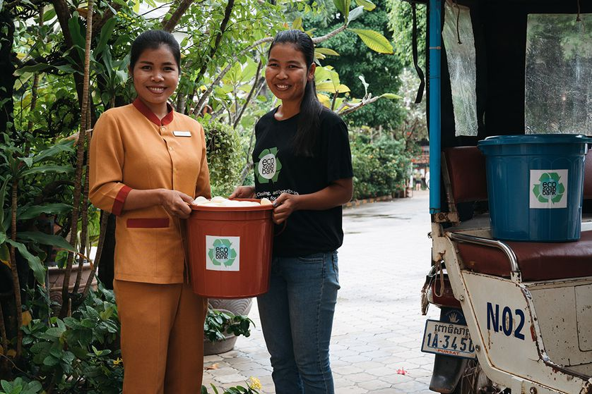 hotel employee hands over recycled soap