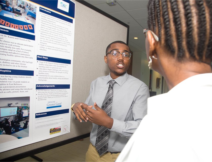 high school student shows research via screen