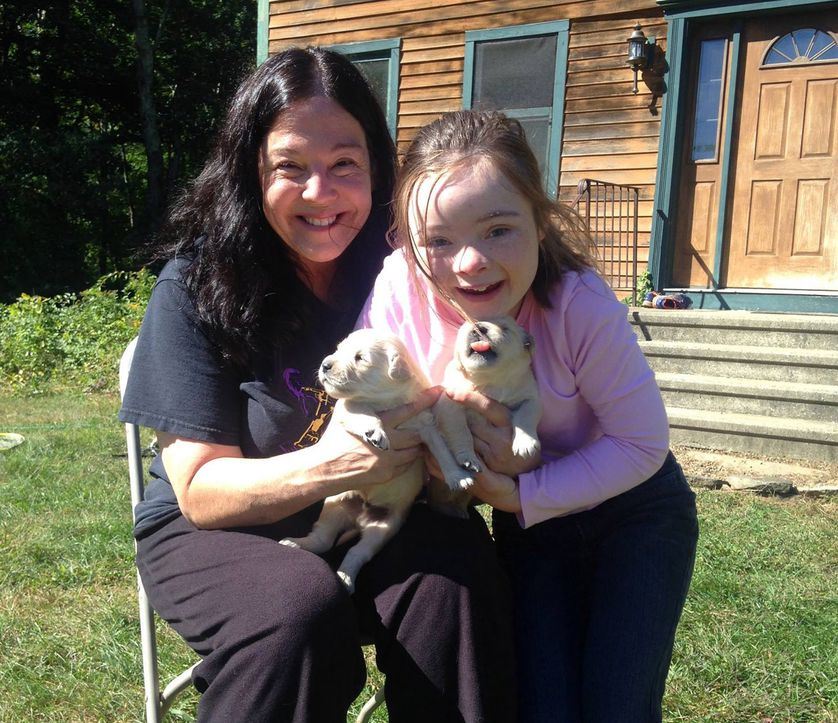 founder of north star foundation with child and two puppies