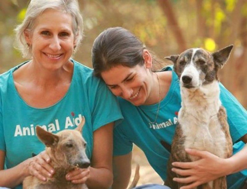 founders of animal aid unlimited with two dogs