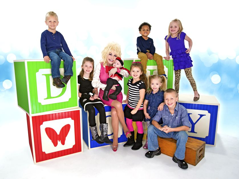 dolly sits on building blocks with kids